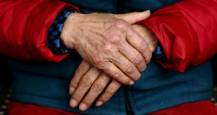 Closeup shot of an elderly woman's wrinkled hands